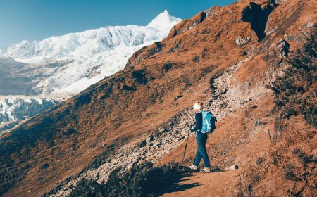Woman with backpack on the mountain trail